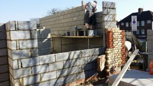 a brick wall of an extension being built